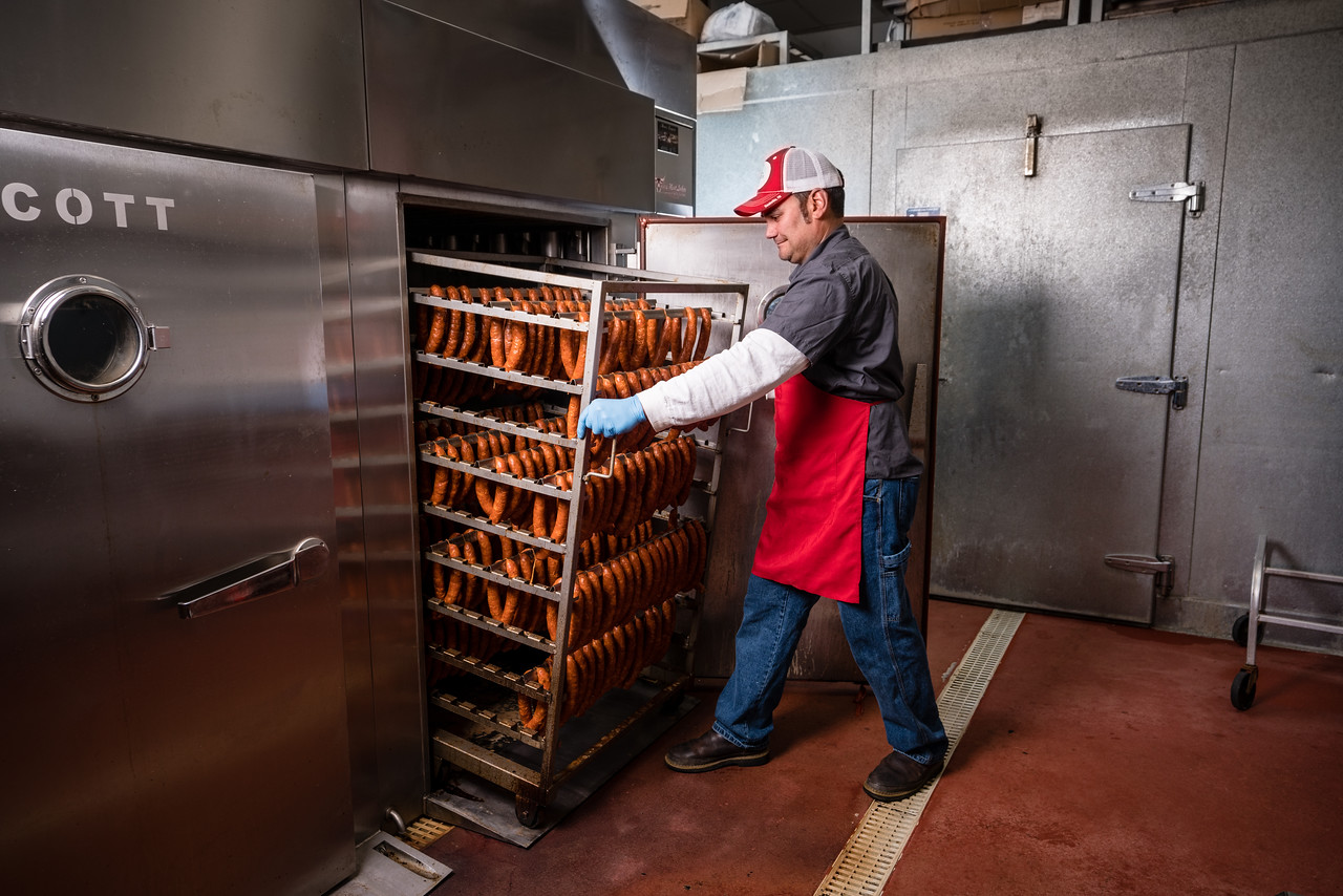 TULARE, CA--Danny Mendes pulls out linguine from one of his smokers at Tulare Meat Locker & Sausage Co. Photo by Tomas Ovalle